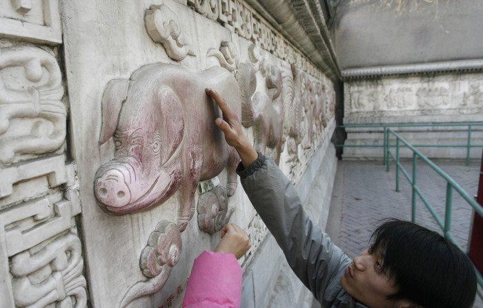 L'economia cinese a rilento, l'anno del maiale non porta ricchezza